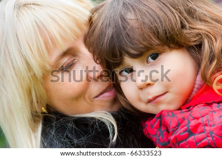 Happy mother and daughter portrait together outdoors
