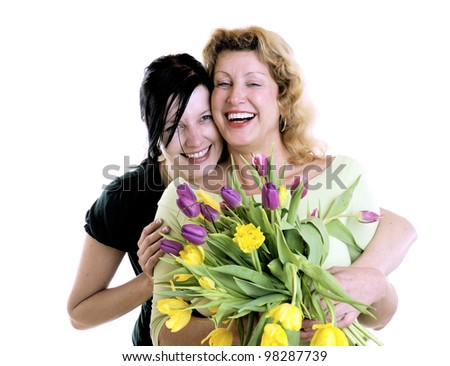 happy mother and daughter with flowers - stock photo