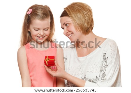 Happy mother and daughter with gift box, Mom gives a gift, isolated on white background - stock photo