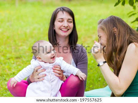 Happy mother and daughter with her babysitter - stock photo