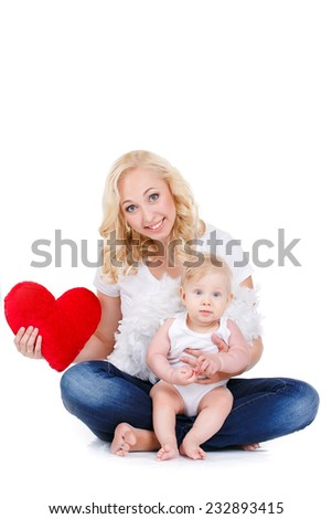 happy mother and her child with red heart, isolated against white background. childhood, parenting and relationship concept - happy mother with adorable little girl and red heart - stock photo
