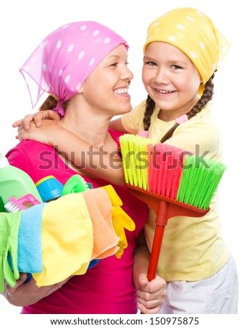 Happy mother and her daughter are dressed for cleaning, isolated over white - stock photo