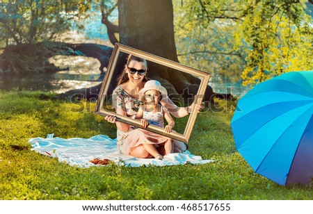 Happy mother and her daughter having fun in park