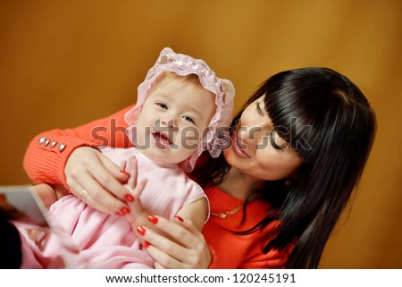 happy mother and her daughter playing at home - stock photo