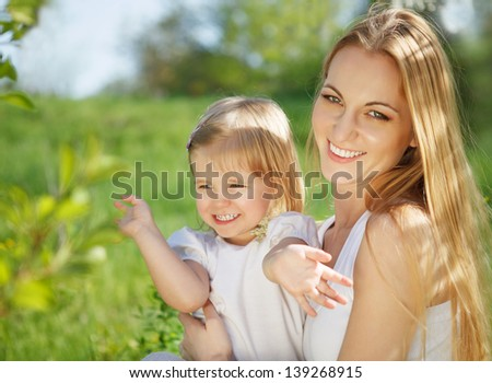 Happy mother and her little daughter in the summer day - stock photo