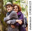 Happy mother and her son outdoors on a hike - stock photo