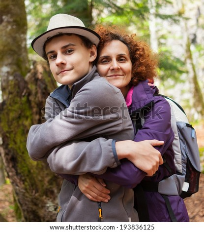 Happy mother and her son outdoors on a hike