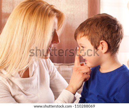 Happy mother and her son spending time together. - stock photo