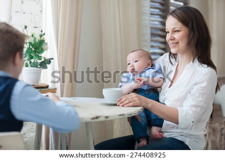 Happy mother and her sons having lunch together - stock photo