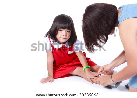 happy mother and her three year old daughter at home socks before going to school - stock photo