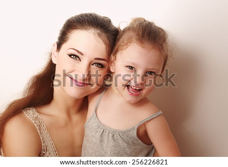 Happy mother and kid girl hugging. Closeup portrait - stock photo