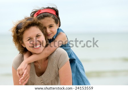 Happy mother and kid on the beach