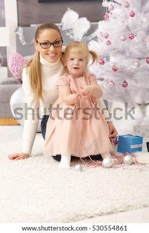 Happy mother and little daughter at christmas time.