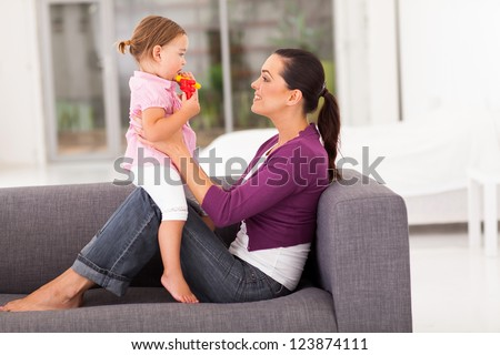 happy mother and little daughter at home - stock photo