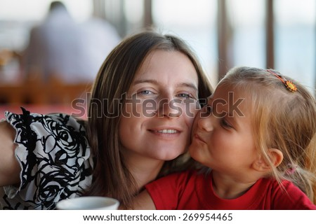 Happy mother and little daughter. Family photo closeup. Shallow depth of field. Selective focus. - stock photo