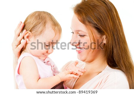 Happy mother and little daughter having fun isolated over white background - stock photo