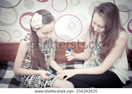 Happy mother and little daughter having girly quality time - stock photo