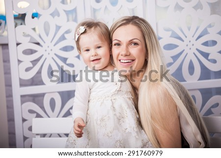 Happy mother and smiling daughter - stock photo