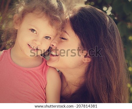 Happy mother and smiling kid. Loving family. Closeup. Instagram effect - stock photo