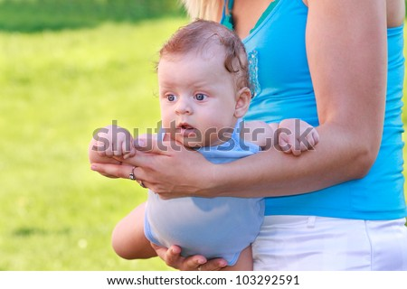 happy mother and son flying on hands - stock photo