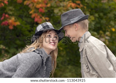 Happy mother and son in autumn park - stock photo