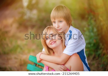 happy mother and son in park - stock photo