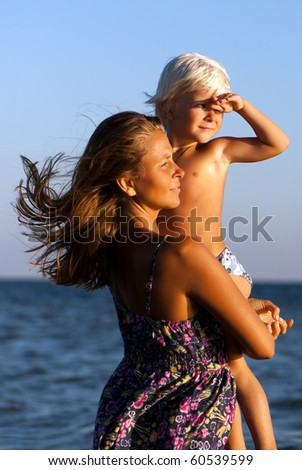 happy mother and son in sea - stock photo