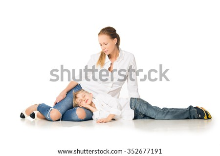 Happy mother and son lying in her lap. Isolated on white background. Shooting in the studio