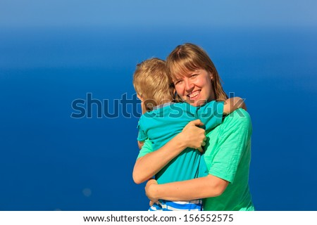 happy mother and son on sea vacation  - stock photo