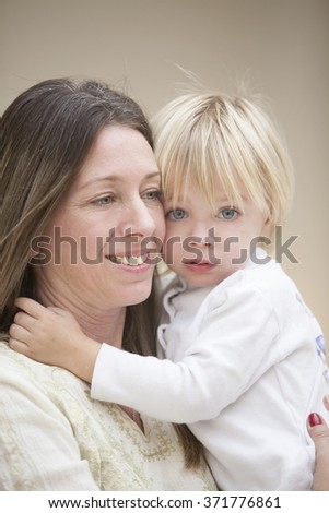 Happy mother and son portrait - stock photo