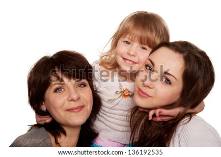 Happy mother and two daughters, a teenager and a toddler. Isolated on white background - stock photo