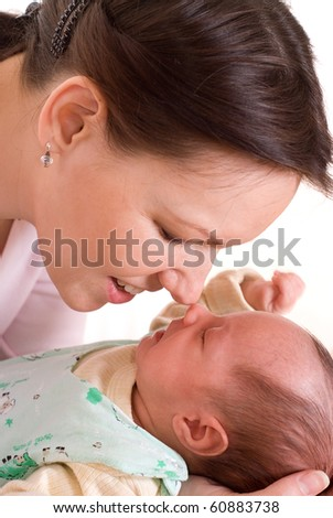 happy  mother at the hands holding newborn - stock photo