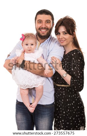 Happy mother,father and baby girl smiling together isolated on white background