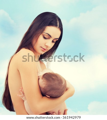 happy mother feeding her adorable baby - stock photo
