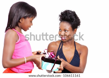 Happy mother gets a gift from little daughter - stock photo