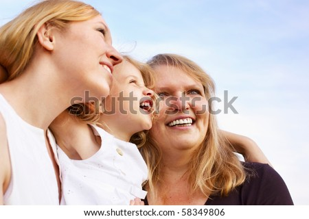 happy mother, grandmother and little girl looking up, outdoor - stock photo