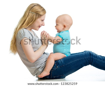 happy mother having fun with her baby boy - stock photo