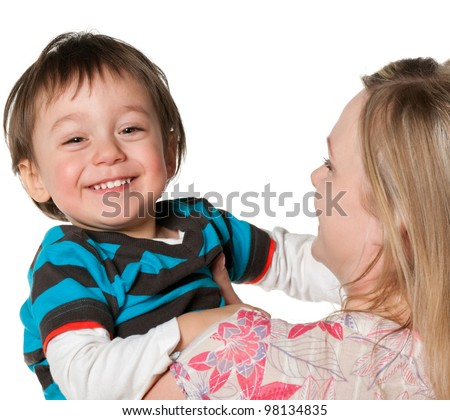 Happy mother holding a little smiling  boy; isolated on the white background