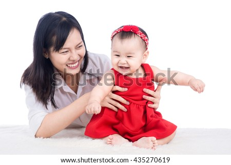 Happy mother holding adorable child baby girl. - stock photo