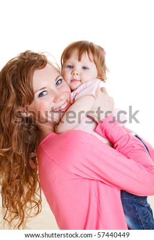 Happy mother holding daughter - stock photo