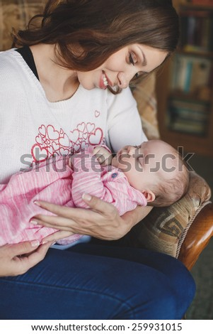 happy mother holding her baby girl. Happy family. A young mother and baby.  - stock photo