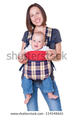 happy mother holding her baby in the knapsack. isolated on white background - stock photo