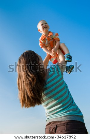 happy mother  holding her son - stock photo