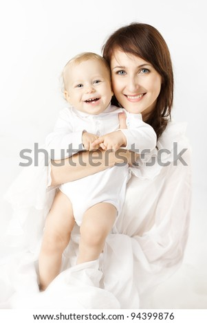 Happy mother holding smiling baby over white