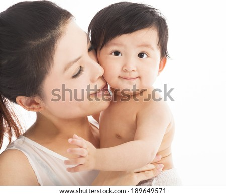Happy  mother holding smiling child baby  - stock photo