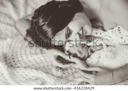 happy mother holding the hand of his beloved child - stock photo