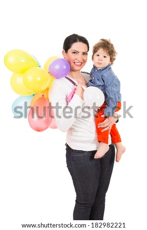 Happy mother holding toddler boy and many balloons isolated on white background - stock photo