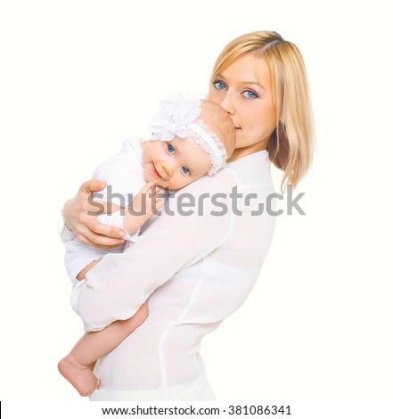 Happy mother hugging baby on a white background - stock photo