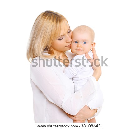 Happy mother hugging her baby on a white background - stock photo