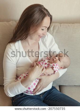 Happy mother hugging her little daughter, baby, newborn, tenderness and love, indoor - stock photo